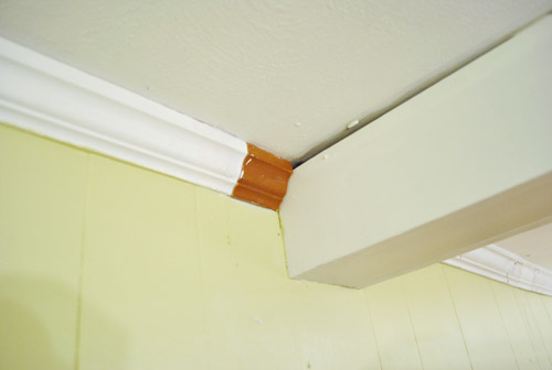 The Shot Below Sort Of Demonstrates How Thinner Trim Along Beams Meets Thicker Around Room
