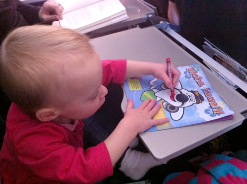 flying with toddler coloring on airplane tray