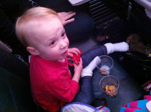 flying with toddler eating snacks on airplane