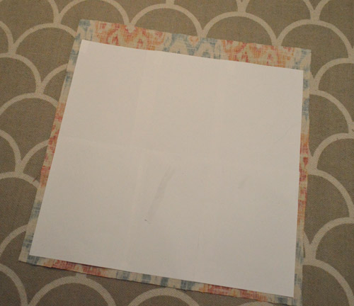 paper template laid overtop fabric
