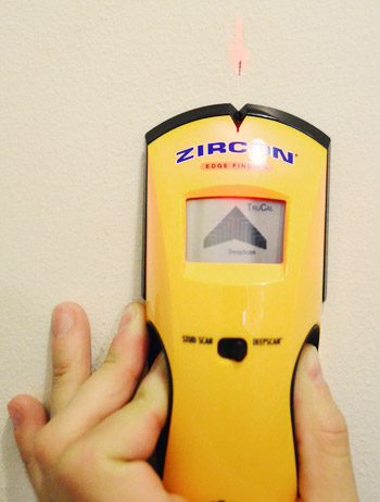 using a Zircon digital stud finder to locate stud within a wall for DIY project