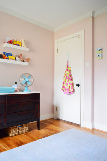 pink girl's bedroom with crown molding on ceiling