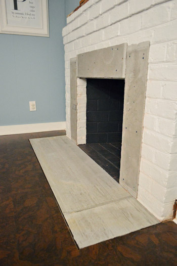 Fireplace makeover tiling the mantel with marble - Tiling a brick fireplace ...