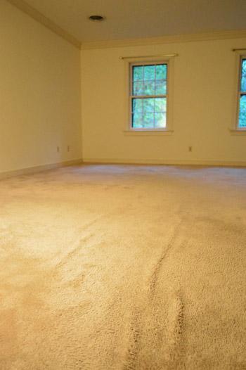 old wrinkled carpet in bedroom