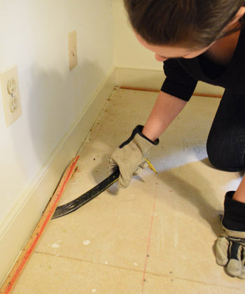 prying up carpet tack strip with crowbar