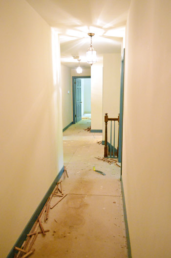 subfloor in hallway with carpet removed