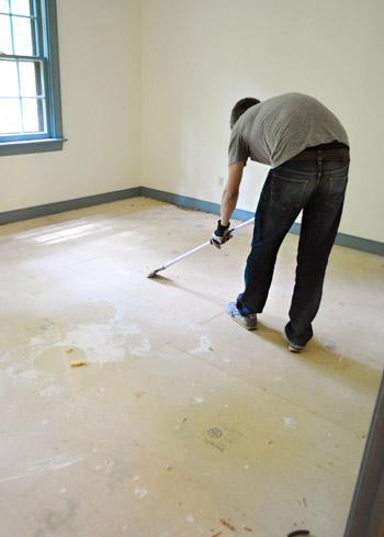 using scraper bar to remove carpet staples