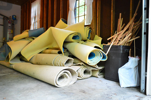 stacks for old carpet rolls ready for removal