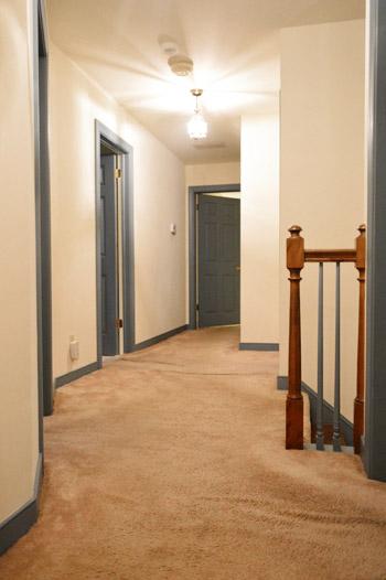 wrinkled old carpet in hallway