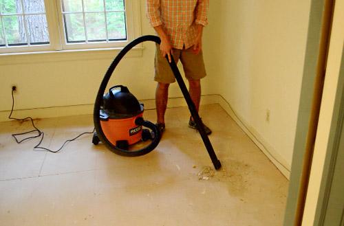 using shopvac to suck up carpet removal debris
