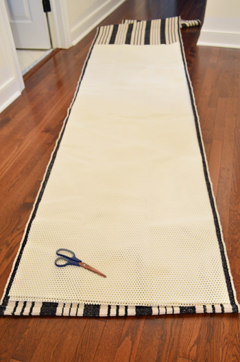 cutting rug pad to the size of a striped stair runner