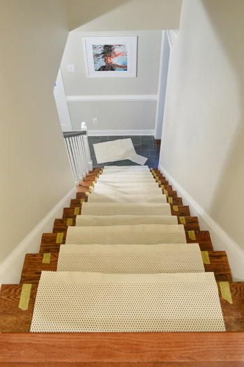 Sections Of Rug Pad Placed On Each Step Staircase Before Runner