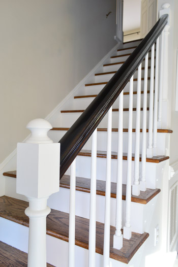 stair railing makeover with white ballasts white pickets and dark railing