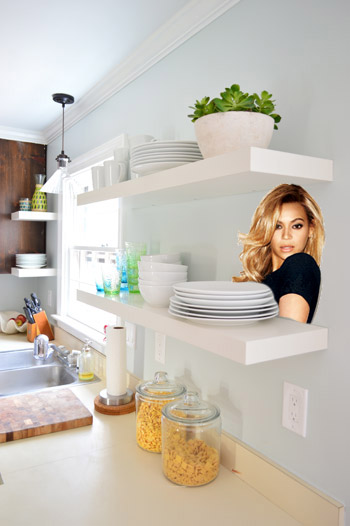 white Ikea Lack floating shelves in our kitchen with Beyonce photoshopped on one of them