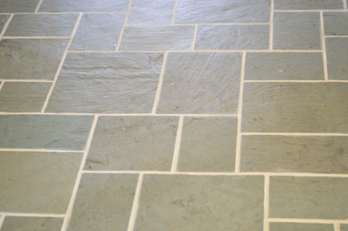 close up of clean grout between slate tile floor after Polyblend Grout Renew application