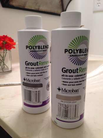two bottles of Polyblend Grout Renew from Home Depot in Natural Gray and Oyster Gray colors