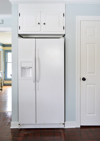 painted white refrigerator in nelson blue kitchen