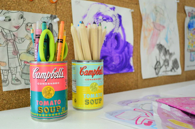 limited edition Campbell's soup cans with Warhol labels used to hold supplies pencils and crayons at kid art desk
