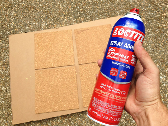 spraying loctite spray adhesive on cork board tiles to affix them to cork board wall