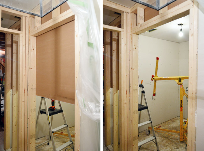 drywall sheet hung across doorway before and after the opening is cut