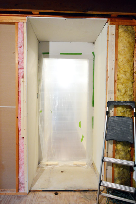inside of bonus room with drywalled vestibule
