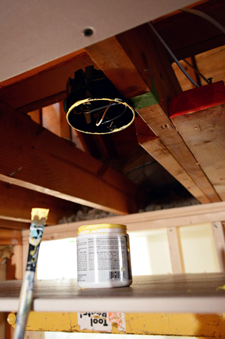 light fixture box in ceiling marked with yellow paint