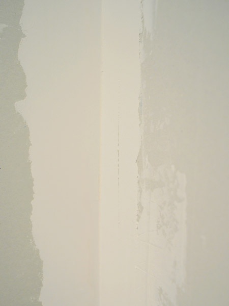 rough edges of drywall mud dried on wall