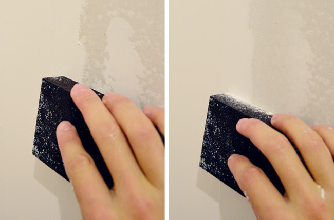 rubbing wet sanding block on drywall mud to smooth