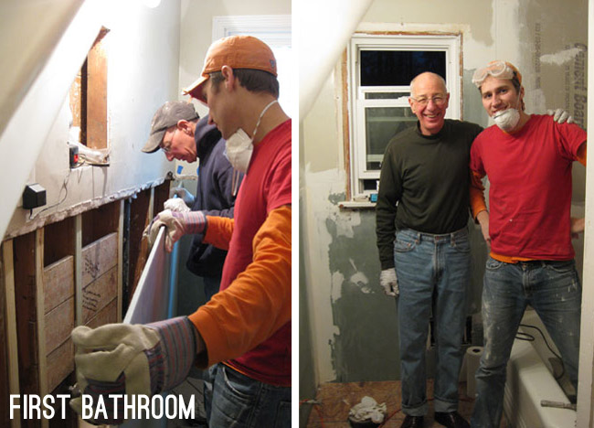 father and son installing drywall in old house's bathroom